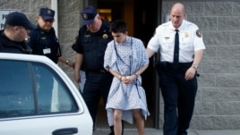 Alex Hribal, the suspect in the stabbings at the Franklin Regional High School near Pittsburgh, is taken from a district magistrate in Export, Pennsylvania, April 9, 2014.