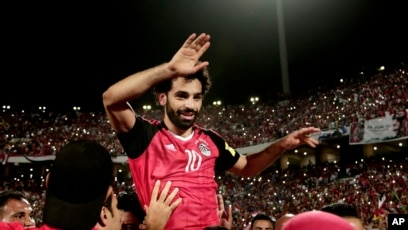 eb2c46de4 Egypt s Mohamed Salah celebrates defeating Congo during the 2018 World Cup  group E qualifying soccer match
