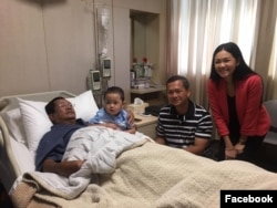 Hun Sen is pictured with his children and grandson during his hospital stay.