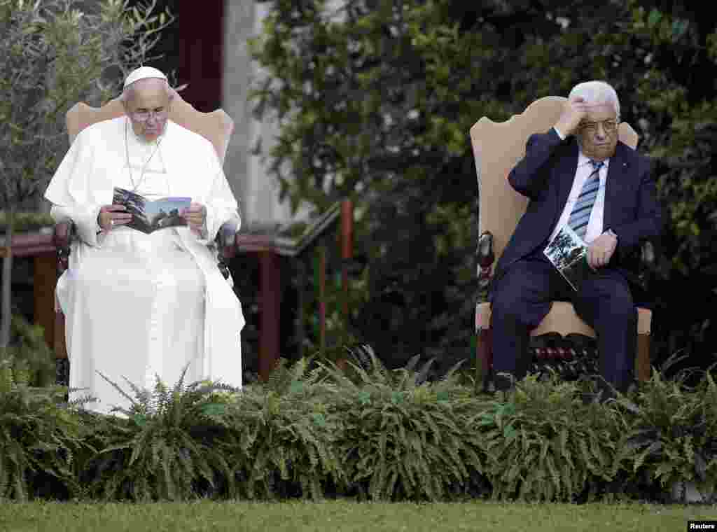 Pope Francis and Palestinian President Mahmoud Abbas are pictured in the Vatican Gardens as they pray with Israeli President Shimon Peres (not pictured) at the Vatican, June 8, 2014.