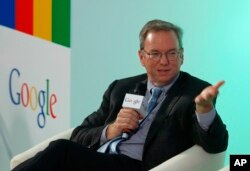 FILE - Eric Schmidt, Executive Chairman of Google, speaks during a session with students at the Chinese University of Hong Kong, in Hong Kong, Nov. 4, 2013.