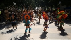 Members of Danza Azteca Guadalupana dance during an event to mark Indigenous Peoples' day at the capitol grounds in Austin, Texas, U.S., October 9, 2021.
