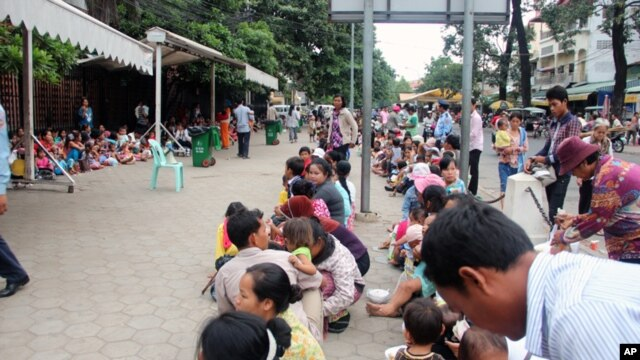 People with their small children are waiting out side Kuntha Bopha hospital in Phnom Penh, Cambodia.