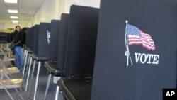 FILE - Voting booths are lined up in Albuquerque, New Mexico, Oct. 26, 2012.