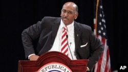 FILE - Michael Steele, then-Republican National Committee (RNC) chairman, announces that he is dropping his re-election bid, Jan. 14, 2011, during the Republican National Committee Winter Meeting in Oxon Hill, Md.