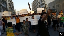 Activists in Syria's besieged Aleppo protest against the United Nations for what they say is its failure to lift the siege of their rebel-held area, Sept. 13, 2016. Dozens of protesters marched in the al-Shaar neighborhood heading toward the Castello road, the area from which aid is expected to be delivered.