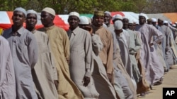 FILE - Men line up in July 2015 after being detained on suspicion of affiliation with Boko Haram.
