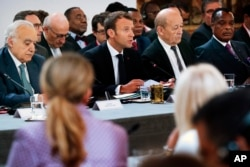 UN Special Envoy for Libya Ghassan Salame, French President Macron, French Foreign Affairs Minister Le Drian and Congo President Denis Sassou Nguesso, attend an International Conference on Libya at the Elysee Palace in Paris, May 29, 2018.