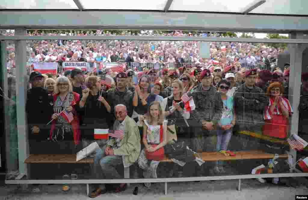 People listen to U.S. President Donald Trump's public speech at Krasinski Square, in Warsaw, July 6, 2017.