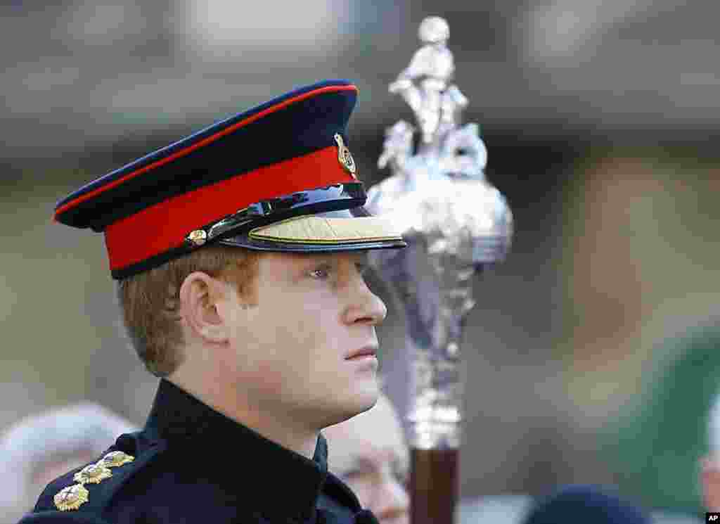 Britain's Prince Harry listens as the 'Last Post' sounds, ahead of a two minutes' silence as he visited the Westminster Field of Remembrance in London.