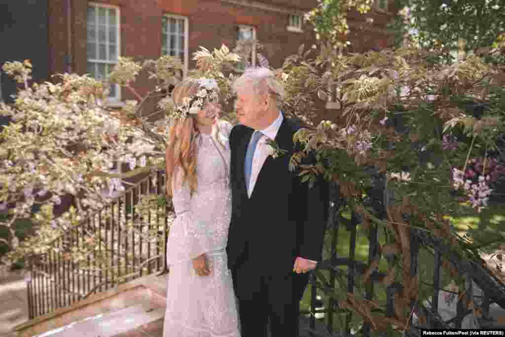 British Prime Minister Boris Johnson and his wife Carrie Johnson are seen in the garden of 10 Downing Street after their wedding in London, May 29, 2021.