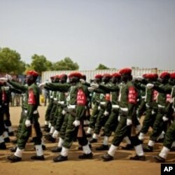 Southern Sudanese military police participate in an independence rehearsal procession in Juba, southern Sudan, July 7, 2011