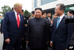 President Donald Trump meets with North Korean leader Kim Jong Un and South Korean President Moon Jae-in, right, at the border village of Panmunjom in the Demilitarized Zone, South Korea, Sunday, June 30, 2019. (AP Photo/Susan Walsh)