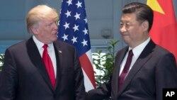 中共總書記習近平與美國川普總統7月8日在德國G-20峰會會晤時資料照。
