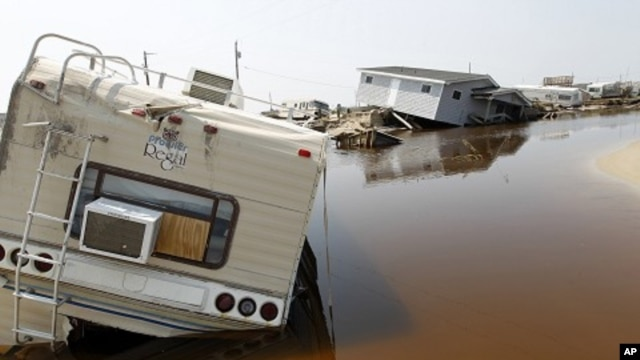 A trailer sits on the beach at the North Beach Campground after being washed out by Hurricane Irene, at Cape Hatteras National Seashore in Rodanthe, North Carolina August 29, 2011.