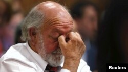 Barry Steenkamp, father of Reeva Steenkamp, reacts as he hears the verdict at the North Gauteng High Court in Pretoria, Sept. 12, 2014.