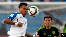 FILE - Honduras' Arnold Peralta jumps for the ball during a World Cup qualifying match against Mexico in San Pedro Sula, Honduras. Police believe Peralta was deliberately murdered.