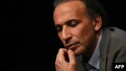 "FILE - This file photo taken on March 26, 2016 shows Swiss Islamologist Tariq Ramadan taking part in a conference on the theme ""Live together"" in Bordeaux."
