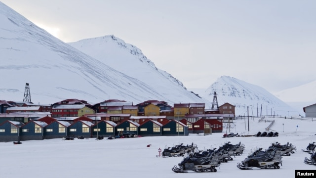 Snow scooters are seen parked in the town of Longyearbyen in Svalbard, March 26, 2012.
