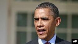 奥巴马总统3月23日在白宫玫瑰园回答记者关于崔旺•马丁的提问