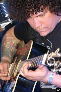 Once involved in death metal music, Engelbrecht is now writing songs using Spanish flamenco guitar