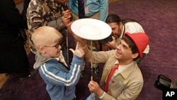 A visually impaired boy learns the joy of spinning at the Big Apple Circus of the Senses.