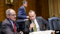 Sen. Jim Risch, R-Idaho (L) and Sen. Mike Lee, R-Utah, confer on Capitol Hill in Washington, Jan. 8, 2015, as the Senate Energy and Natural Resources Committee gathered for a markup on the long-stalled Keystone XL pipeline bill.
