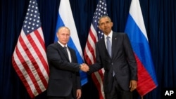 Presiden AS Barack Obama dan Presiden Rusia Vladimir Putin di Markas Besar PBB, New York, 28 September 2015 (AP Photo/Andrew Harnik).