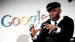 FILE - Musician Mos Def speaks on a panel discussing Google's new music search in Los Angeles, Oct. 28, 2009.