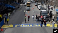 The newly applied Boston Marathon finish line rests on Boylston St., April 13, 2017, in Boston. The finish line is made from an adhesive decal that covers a painted version that is left in place throughout the year. The 121st Boston Marathon is to be run