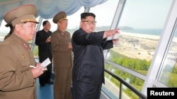 FILE PHOTO - North Korean leader Kim Jong Un inspects the construction site of the Wonsan-Kalma coastal tourist area as Kim Su Gil, 3rd from left, newly appointed director of the General Political Bureau of the Korean People's Army, looks on, in this undated photo.