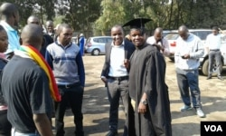 A graduate wearing his gown in Harare, July 26, 2016.