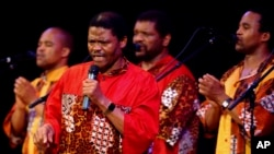 South African singing group Ladysmith Black Mambazo performs Sunday, April 10, 2005, at Town Hall in New York. Leader and founder Joseph Shabalala,center, sings in front of the others in the group.. (AP Photo/Chad Rachman)