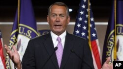 House Speaker John Boehner of Ohio gestures during a news conference on Capitol Hill in Washington, Jan. 8, 2015.