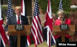 FILE - Britain's Prime Minister Theresa May and U.S. President Donald Trump hold a joint news conference at Chequers, the official country residence of the prime minister, in Buckinghamshire, England, July 13, 2018.