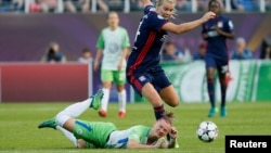 FILE - Olympique Lyonnais faces off against VfL Wolfsburg in the women's Champions League final at Valeriy Lobanovskyi Stadium, Kyiv, Ukraine, May 24, 2018.