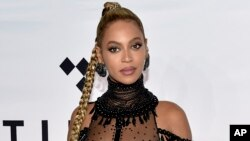 FILE - In this Oct. 15, 2016 photo, singer Beyonce Knowles attends the Tidal X: 1015 benefit concert in New York.