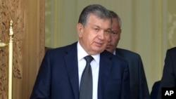 Uzbekistan's Shavkat Mirziyoyev speaks with Russian President Vladimir Putin (not pictured) in Samarkand, Uzbekistan, Sept. 6, 2016.