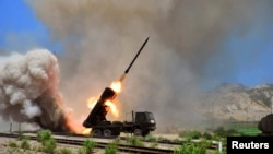 在朝鲜发布的为表明日期的图片上可以看到多管导弹发射器(资料照片)