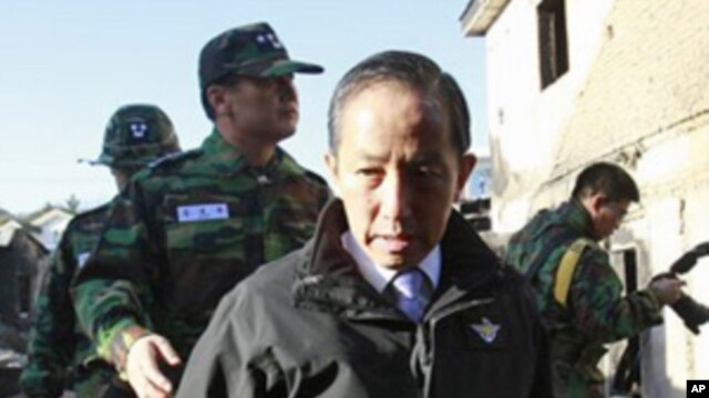 South Korean Defense Minister Kim Tae-young, who has resigned, looks at the destroyed houses on Yeonpyeong Island, South Korea, Nov. 25, 2010.