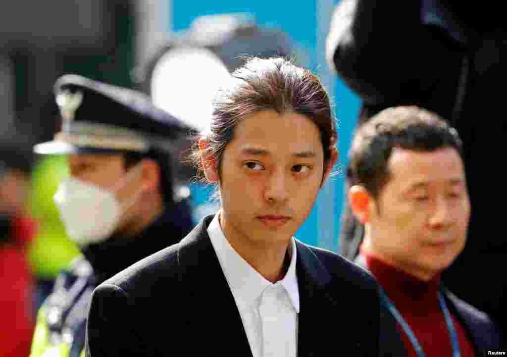 South Korean singer Jung Joon-young arrives for questioning on accusations of illegally filming and sharing sex videos on social media, at the Seoul Metropolitan Police Agency in Seoul.