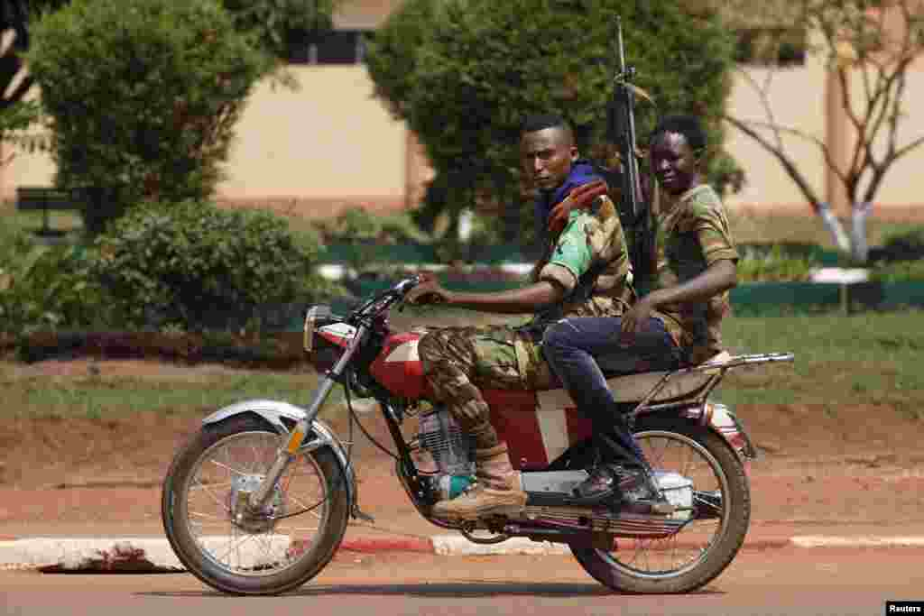 Seleka soldiers ride a motorcycle during fighting in Bangui, Central African Republic, Dec. 5, 2013.