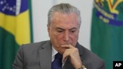 FILE - Brazil's President Michel Temer attends a ceremony at the Planalto presidential palace, in Brasilia, Brazil, April 12, 2017.