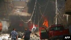 Lực lượng an ninh Iraq canh gác tại hiện trường vụ đánh bom ở Karbala, 80 km (50 dặm) về phía nam Baghdad, ngày 25/9/2011