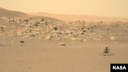 This file photo, captured by NASA's Perseverance rover, shows the Ingenuity helicopter on the surface of Mars. The image was received on June 15, 2021. (Credit: NASA/JPL-Caltech/ASU)
