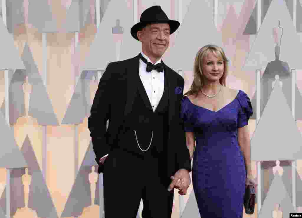 "J.K. Simmons, best supporting actor nominee for his role in ""Whiplash,"" and his wife Michelle Schumacher arrive at the 87th Academy Awards in Hollywood, California, Feb. 22, 2015."
