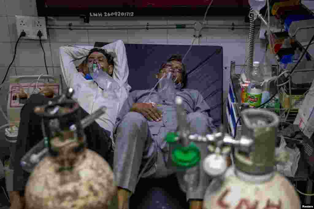 Patients suffering from the COVID-19 get treatment in Lok Nayak Jai Prakash (LNJP) hospital, in New Delhi, India.