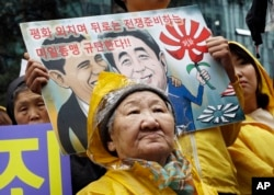 FILE - Former comfort woman Kil Un-ock who was forced to serve for the Japanese troops as a sexual slave during World War II, attends a rally against a visit by Japanese Prime Minster Shinzo Abe to the United States, in front of the Japanese Embassy in Seoul.