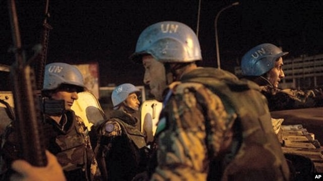 UN peacekeepers from Jordan provide security at night on the streets of Abidjan, Ivory Coast, April 4, 2011