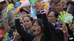 Anti-government protesters shout on the stage during a rally against a political amnesty bill at the democracy monument in Bangkok, Thailand, Nov. 8, 2013.